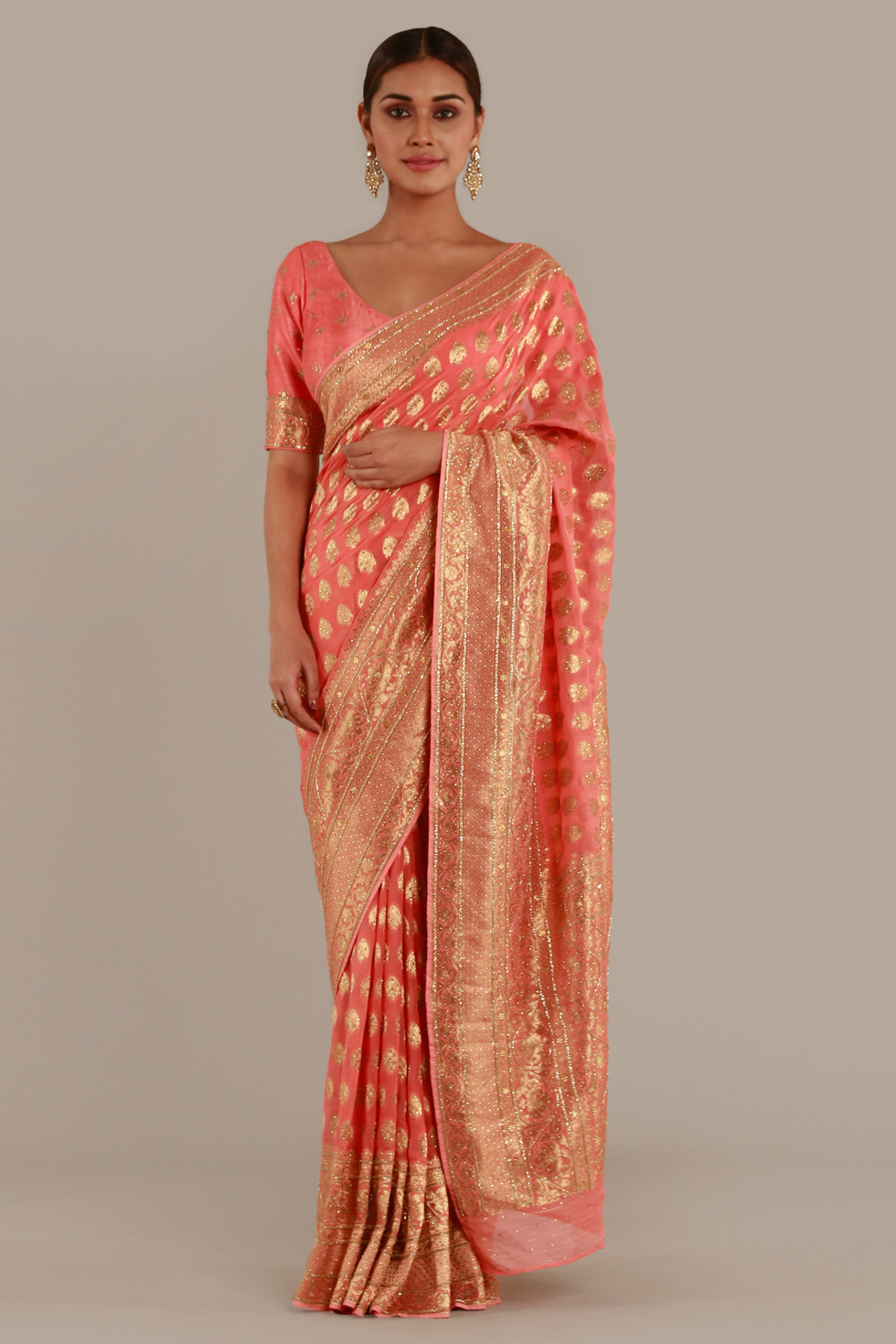 Peach pink classic saree with gold butis, embellishments and matching blouse