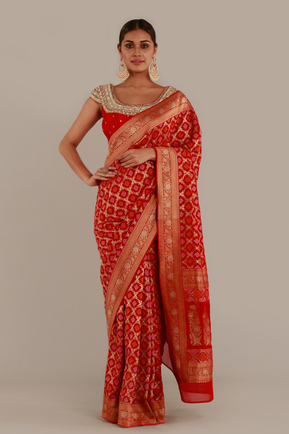 Ruby red and gold classic Banarasi saree with matching choli, gold embroidered neckline and butis