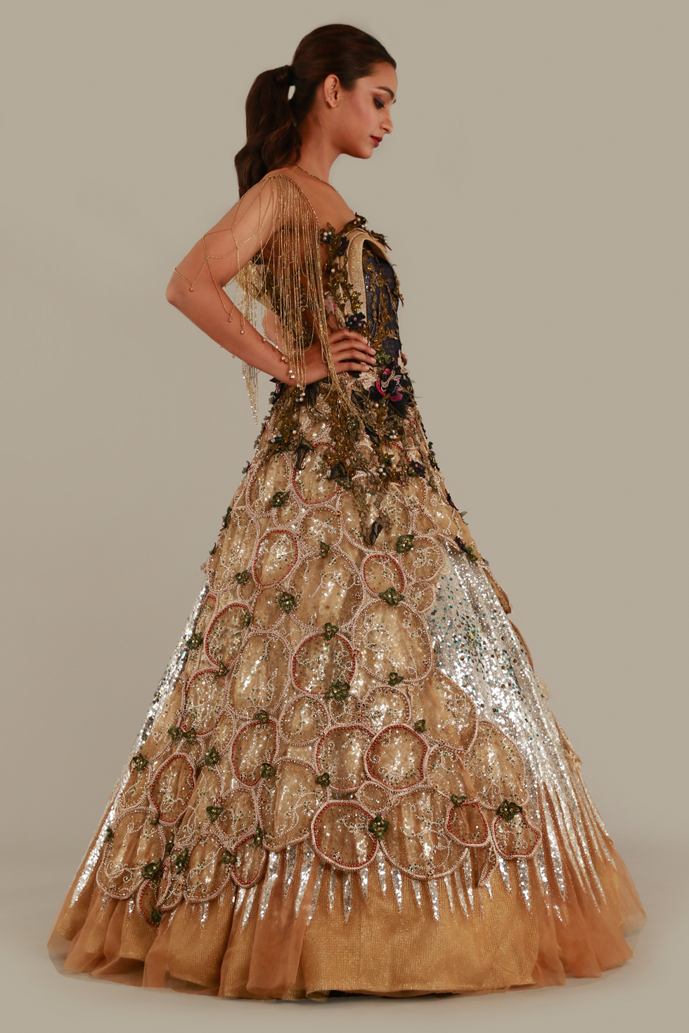 Beige gold shimmery gown with cut work, silver sequins, illusion neckline and tassels